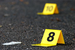 Crime Evidence Marker on Asphalt Stock Image