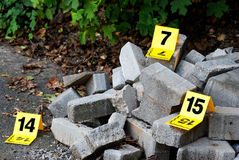 Crime Evidence Marker Next to Concrete Royalty Free Stock Photo