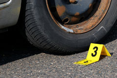 Crime Evidence Marker Next to Tire Royalty Free Stock Photography