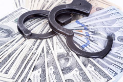 Crime and Money. Handcuffs are on the dollar Royalty Free Stock Photography