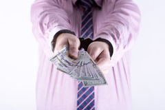 Crime and Money. Handcuffs are on the dollar Stock Image