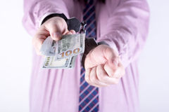 Crime and Money. Handcuffs are on the dollar. Photo showing money with handcuffs Royalty Free Stock Photo