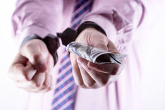 Crime and Money. Handcuffs are on the dollar. Photo showing money with handcuffs Stock Photo