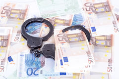 Crime and Money. Handcuffs are on the euro. Photo showing money with handcuffs Stock Images