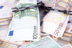 Crime and Money. Handcuffs are on the euro. Photo showing money with handcuffs Stock Photos