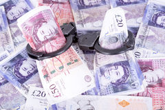 Crime and Money. Handcuffs are on the pounds Royalty Free Stock Images