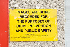 Crime prevention notice. An image of a yellow notice indicating the recording of images by video camera for crime prevention purposes and public safety royalty free stock photography