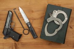 Crime and Punishment. Equipment criminals. The Book of of laws with handcuffs. Stock Photos