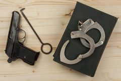 Crime and Punishment. Equipment criminals. The Book of of laws with handcuffs. Stock Images