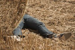 Crime scene. Woman lying dead in the field Stock Photo