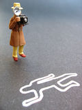 Crime scene. A crime scene photographer taking picture of chalk line body Stock Photography