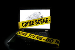 Crime scene. Laptop computer with crime scene tape across it royalty free stock photography