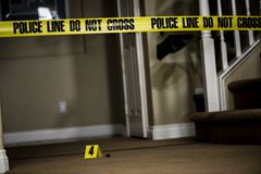 Crime scene. The number 4 crime scene marker on the floor of a house Stock Photography