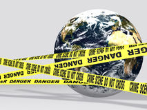 Crime scene. Our planet in danger, victim of the humanity and represented behind ''crime scene'' tapes Stock Photos