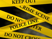 Crime scene. Crime area restricted by several yellow police line tapes Stock Photo