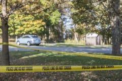 Crime scene blocked off with police tape Stock Photo