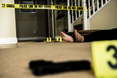 Crime scene. A body on the ground of a crime scene with a gun in the foreground royalty free stock photos