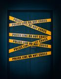 Crime scene closed door with yellow stripes text Police line do not cross Stock Photo