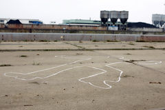 Crime Scene Concept. Outline of a dead body made with chalk on an industrial estate Stock Images