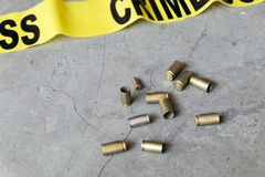 Crime scene concept with crime tape and bullet casings Royalty Free Stock Image