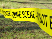 Crime Scene Cordon. Crime scene tape being used to protect a criminal investigation royalty free stock image