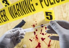 Crime scene for cutting weapon, Judicial police takes blood samples in scene of murder, conceptual image. Conceptual image stock photos