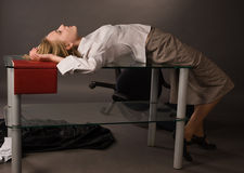 Crime scene with dead college girl. Dead college girl lying on the table Stock Photos