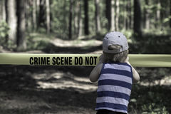 Crime Scene Do Not Cross. Little Boy with a hat.  royalty free stock photos