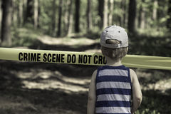 Crime Scene Do Not Cross. Little Boy with a hat.  stock photo