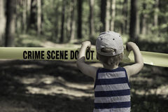Crime Scene Do Not Cross. Little Boy with a hat.  stock image