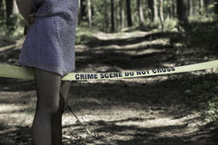 Crime Scene Do Not Cross. Woman in the woods Royalty Free Stock Images