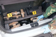 Crime scene: drug smuggling in the trunk of a car Stock Photo