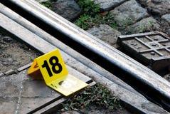 Crime Scene Evidence Marker Near to Rails Stock Photo