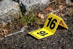 Crime Scene Evidence Marker Next to Syringe. Real police crime scene evidence markers stock image