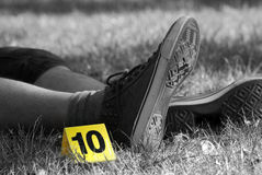 Crime Scene Evidence Markers Near to Legs Royalty Free Stock Photos