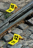 Crime Scene Evidence Markers Near to Rails Royalty Free Stock Images