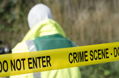 Crime Scene. Forensic detective working at a crime scene Stock Photos