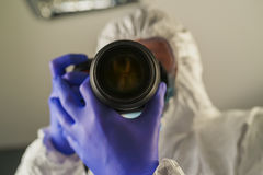 Crime scene forensics investigator with digital camera Stock Photo