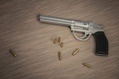 Crime scene. Gun with many bullets on wooden background. 3D rendered illustration.  Stock Image