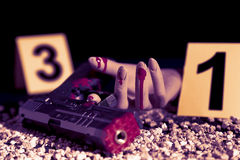 Crime scene of a gunfight in the night. Vintage color filtered look Royalty Free Stock Images