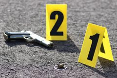 Crime scene. Id tents at crime scene after gunfight Stock Photos