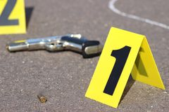 Crime scene. Id tents at crime scene after gunfight Stock Image