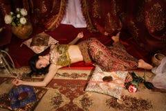 Crime Scene Imitation: Lifeless Woman In Oriental Costume Lying Stock Image