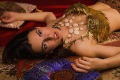Crime scene imitation: lifeless woman in oriental costume lying Stock Photo