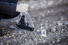 Crime scene investigation - collecting pistol on way Royalty Free Stock Image
