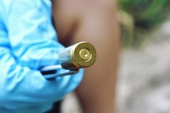 Crime scene investigation. Crime scene investigation, Detective collecting bullet shell Royalty Free Stock Images