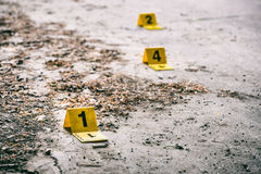 Crime scene investigation. Crime scene markers on dirty ground royalty free stock photos