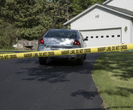Crime scene marked off with tape Stock Photography