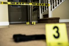 Crime scene. A crime scene with number markers and evidence on the floor stock photos