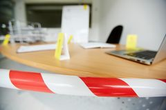 Scene of crime. Crime scene in office bound by police tape to save fingerprints and other evidence stock photography
